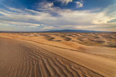 Beautiful yellow dune in the desert. Gobi Desert. Stock Photo