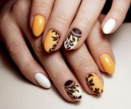 Beautiful yellow manicure design for nails. Nails design art. royalty free stock image