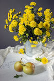 Beautiful yellow mums and pears Stock Photography