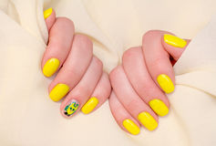 Beautiful yellow nails manicure. Light manicure in light on a white background. stock photos