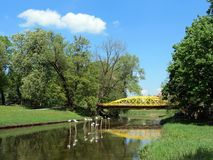 Old yellow metallic bridge by river Sysa, Lithuania Stock Photography