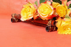 Beautiful yellow roses. On a bamboo tray Stock Photos
