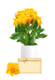 Beautiful yellow roses in vase and greeting card isolated Stock Photography