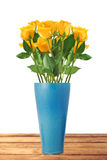 Beautiful yellow roses in vase on wooden table  on white Royalty Free Stock Photos