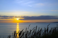 Beautiful yellow sunset over loop head Royalty Free Stock Photography