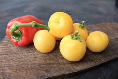 Beautiful yellow tomatoes and bell pepper Royalty Free Stock Photography