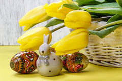Beautiful yellow tulips, easter eggs and ceramic rabbit Royalty Free Stock Photo