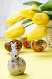 Beautiful yellow tulips, easter eggs and ceramic rabbit Royalty Free Stock Image