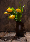 Beautiful yellow tulips in  vase Stock Photography