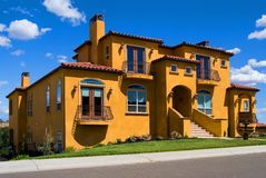 Beautiful yellow villa. With white clouds above Royalty Free Stock Photos