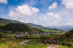 The beautiful Yi nationality village. There is a national minority which called YiZu in Sichuan province of China. They have lived in DaLiangShan area for Stock Photo