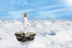 Beautiful yoga above clouds Royalty Free Stock Images