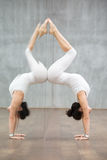 Beautiful Yoga: handstand pose with backbend Royalty Free Stock Image
