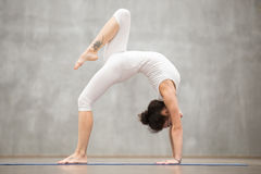 Beautiful Yoga: One legged Wheel pose Royalty Free Stock Images
