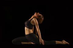 Beautiful yoga posing on black  background Royalty Free Stock Photography