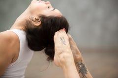 Beautiful Yoga: Raja bhudjangasana pose Stock Images