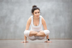 Beautiful Yoga: Scale Posture. Portrait of beautiful young woman wearing white sportswear working out against grey wall, doing yoga or pilates exercise. Arm stock photography