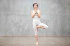 Beautiful Yoga: Tree pose Royalty Free Stock Photos