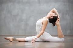 Beautiful Yoga: Variation of Monkey god pose Stock Photography