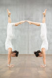 Beautiful Yoga: woman doing handstand posture Royalty Free Stock Images