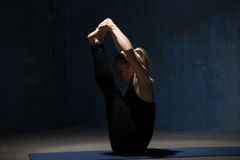Beautiful Yoga Woman Doing Ubhaya Padangusthasana pose Royalty Free Stock Photography