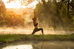 Beautiful Yoga woman in the morning at the hot spring park. Soft and select focus Royalty Free Stock Photography