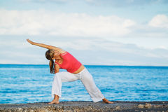 Beautiful Yoga woman Practicing Royalty Free Stock Photos