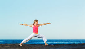 Beautiful Yoga woman Practicing Stock Photography
