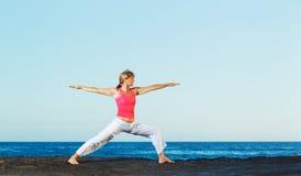 Beautiful Yoga woman Practicing Stock Photography