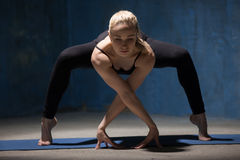 Beautiful Yoga Woman standing in Forward Bending Squat Royalty Free Stock Photography