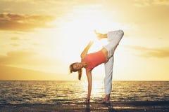 Beautiful Yoga Woman at Sunset Stock Image