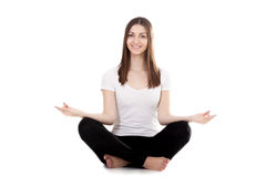 Beautiful yogi female squat cross-legged Stock Images