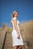 Beautiful yong woman outdoors. Beautiful yong woman wearing a white dress outdoors Royalty Free Stock Photography
