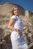 Beautiful yong woman outdoors. Beautiful yong woman wearing a white dress outdoors Royalty Free Stock Images