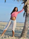 Beautiful youn biracial woman on beach Stock Photos