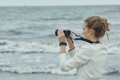Beautiful youn girl with camera Stock Photography