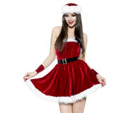 Beautiful younf brunette woman as santa girl. Christmas portrait Stock Photography
