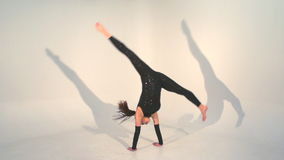 Beautiful young acrobat dance in slow motion stock footage