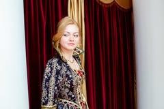 Beautiful young actress smiles wistfully at camera Stock Image