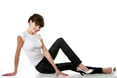 Beautiful young adult girl posing in a studio Stock Photography