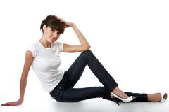 Beautiful young adult girl posing in a studio Stock Image