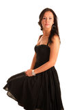 Beautiful young adult girl sits in black dress Royalty Free Stock Image