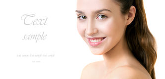 Beautiful young adult woman with clean fresh skin on white backg Stock Photos