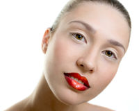 Beautiful young adult woman with red lips. On white background, make up, fashion Stock Images