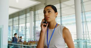 Beautiful young African American businesswoman talking on mobile phone in office 4k. Front view of beautiful young African American businesswoman talking on stock video