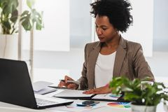 Free Beautiful Young African American Businesswoman Working On Computer At Her Office Royalty Free Stock Photo - 164856725