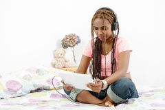 Beautiful young african american woman with braids using a table Royalty Free Stock Image