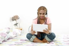 Beautiful young african american woman with braids using a table Stock Photography