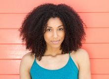 Beautiful young african american woman with curly hair royalty free stock photography