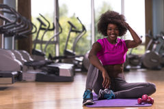 African american woman exercise yoga in gym. Beautiful young african american woman exercise yoga in gym Stock Photos